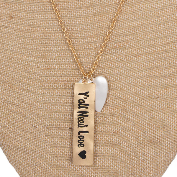 """Long metal necklace stamped with """"Y'all need Love."""" Approximately 32"""" in length."""