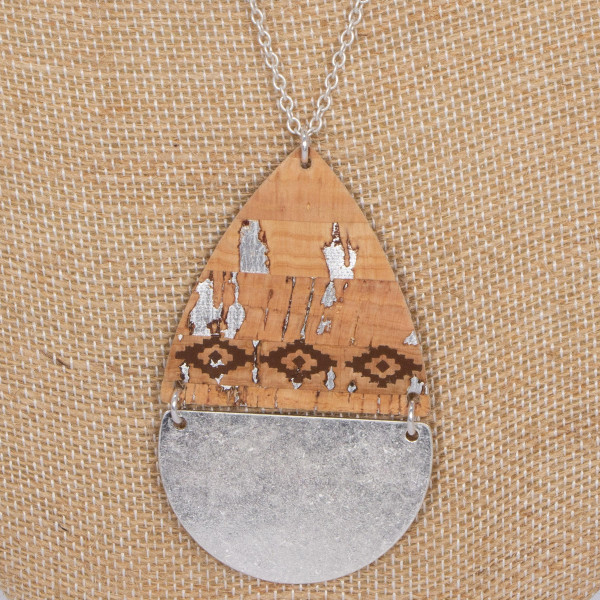 "Long metal necklace with cork pendant and metal detail. Approximately 32"" in length with a 2"" pendant."