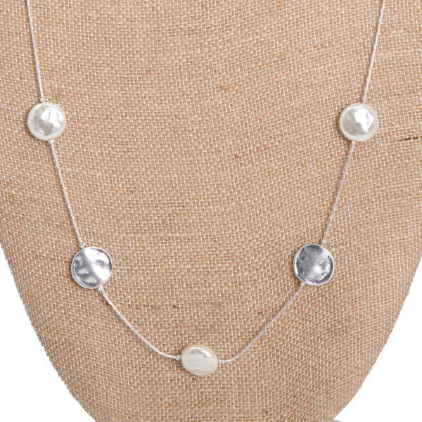 """Long necklace with pearl and metal focals. Approximately 28"""" in length."""