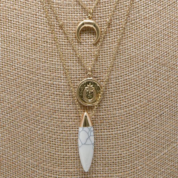 "Layered necklace with stone and horn charm. Approximately 16-20"" in length."