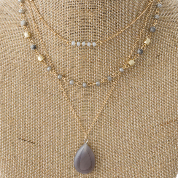"Layered necklace with natural stone charm. Approximately 14""-18"" in length."