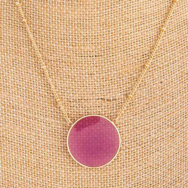 """Long gold metal necklace with acetate circle pendant. Approximate 14"""" in length."""