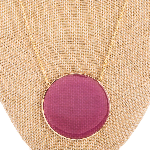 """Long gold metal necklace with acetate circle shaped pendant. Approximate 32"""" in length with 2"""" in diameter pendant."""