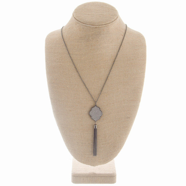 """Long metal necklace featuring a glitter moroccan shaped pendant with tassel. Approximate 36"""" in length with a 4.5"""" pendant."""
