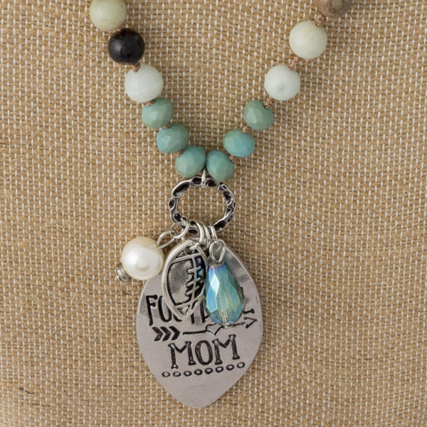 """Long beaded necklace with football mom pendant. Approximately 30"""" in length."""