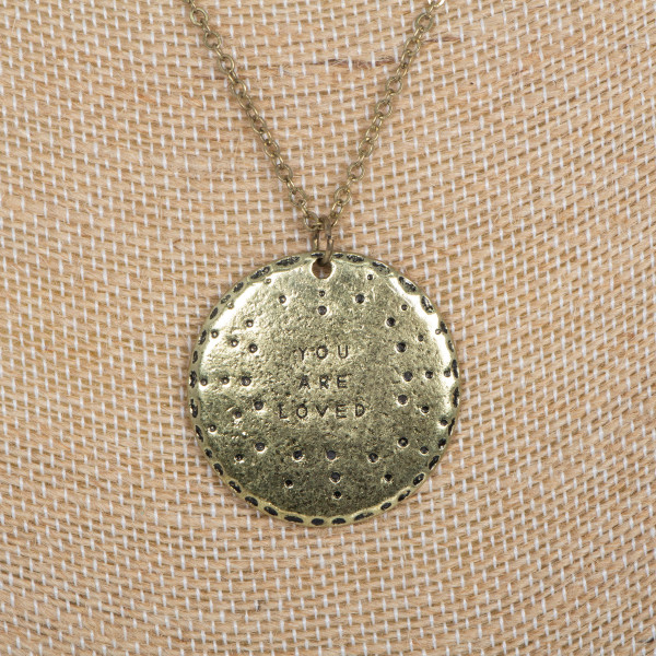 """Short metal necklace stamped with You Are Loved. Approximately 16"""" in length."""