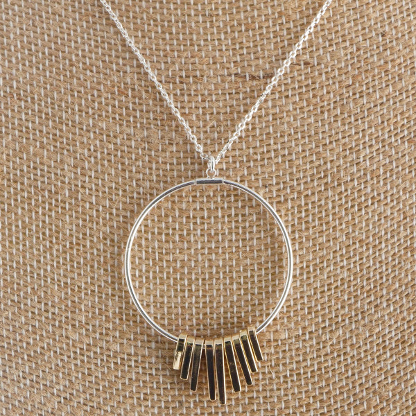 "Long circled spike necklace. Approximate 18"" in length with 1"" pendant."