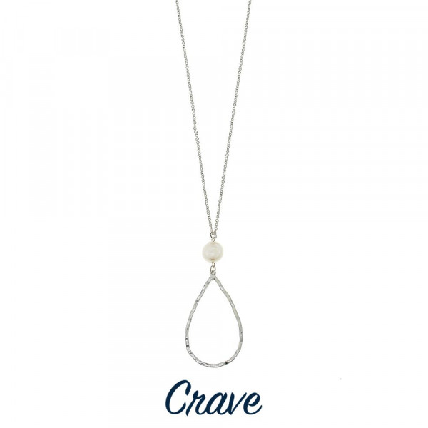 "Long Crave necklace with pendant and pearl details. Approximate 36"" in length."