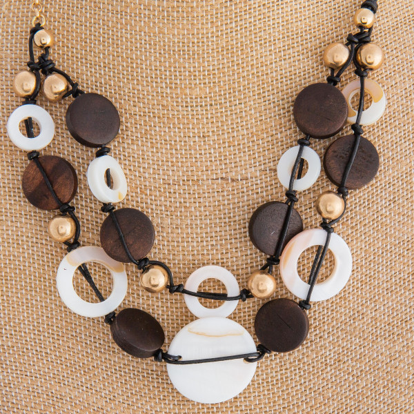 "Cute short necklace with acetate and wood details. Approximate 16"" in length."
