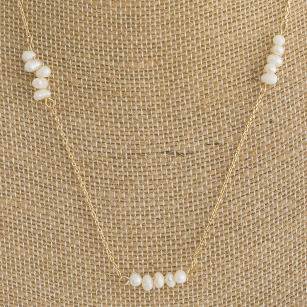 "Dainty pearl necklace. Approximately 16"" in length."