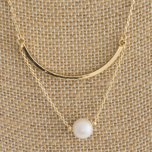 "Short metal necklace with pearl detail. Approximately 16"" in length."