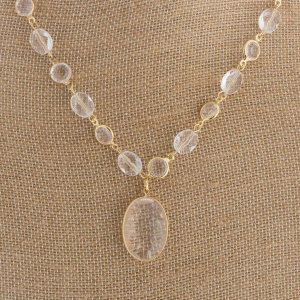 """Long metal necklace featuring a oval pendant. Approximate 18"""" in length with a 1"""" pendant."""