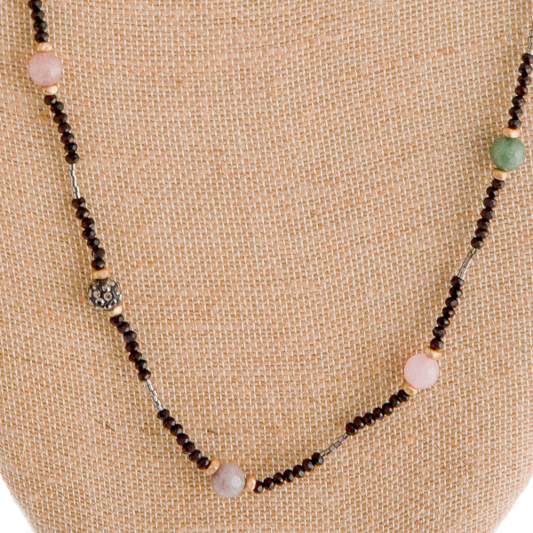 "Long beaded necklace with some natural stones. Approximate 34"" long."