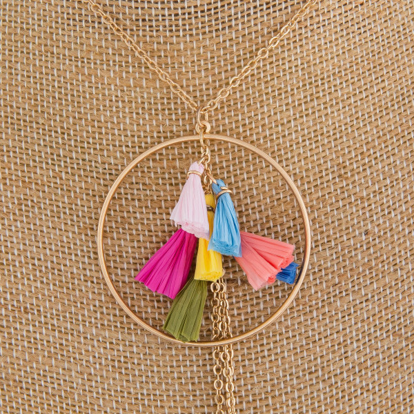 """Long metal necklace with tassel pendant. Approximate 26"""" in length."""