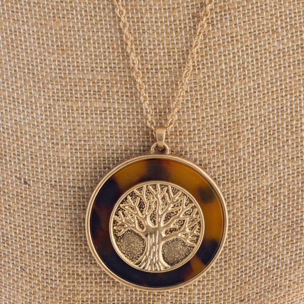 "Long metal necklace with circle pendant. Approximately 34"" in length with a 2.0"" pendant."