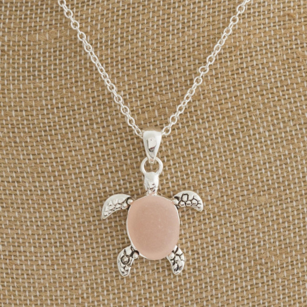 "Beautiful long metal neck with  'Sea turtle"" pendant with natural stone. Approximate 18"" in length with 1"" pendant."