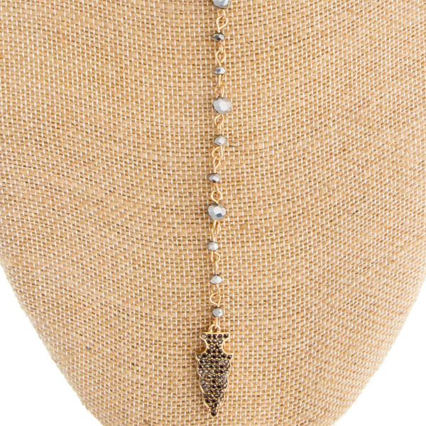 "Stud ball Earring and necklace set- includes layered metal necklace with beads and rhinestone detail pendant. Approximate 26"" long with 1"" pendant."