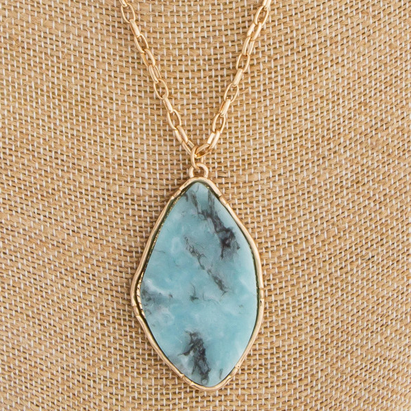 """Long gold metal layered necklace with natural stone pendant. Approximate 18"""" in length with 2"""" pendant."""