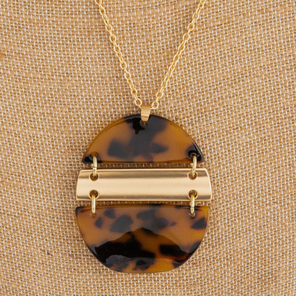 "Long gold metal necklace with acetate  pendant.  Approximate 32"" in length with 2"" pendant."