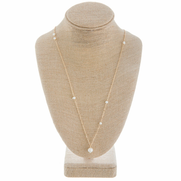 """Gorgeous gold pearl necklace with several pearl charms. Approximate 28"""" in length."""