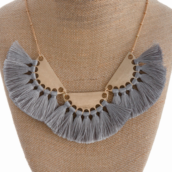 """Long gold necklace with tassel details. Approximate 16"""" in length."""
