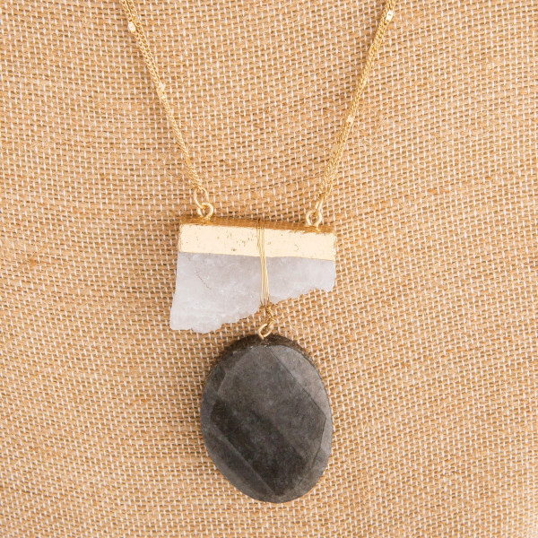 "Long gold metal necklace with natural stone pendant. Approximate 34"" in length with 2"" pendant."