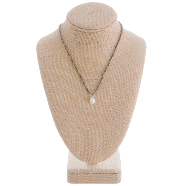 """Long beaded necklace with pearl pendant. Approximate 16"""" in length with .5"""" pendant."""