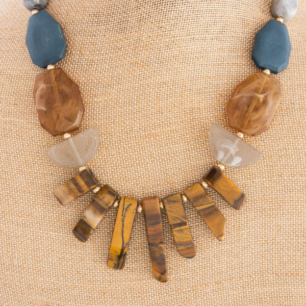 "Gorgeous short beaded necklace with cute natural stone details. Approximate 16"" in length."