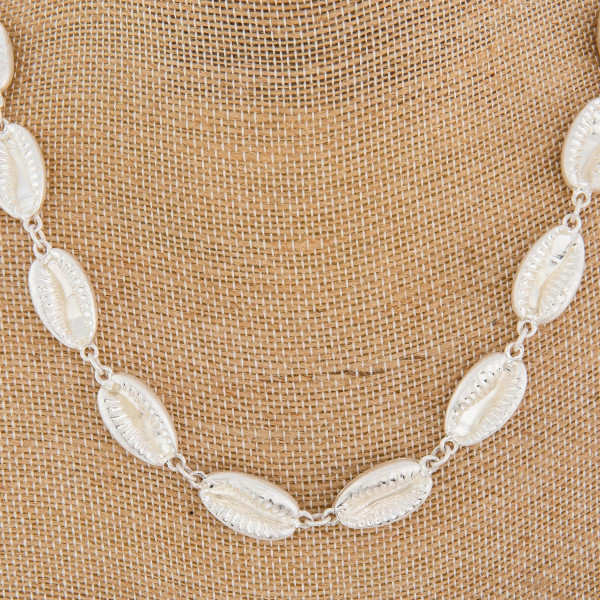 "Silver medium length metal puka shell beaded necklace. Approximately 18"" in length."