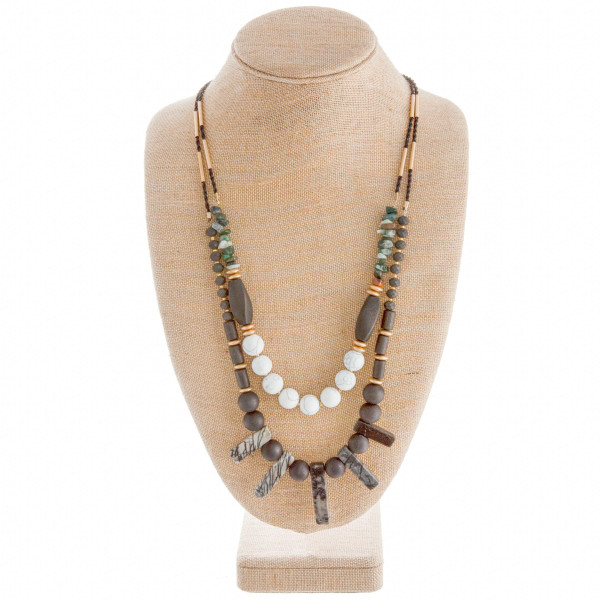 "Long rope necklace with bead and natural stone details. Approximate 27"" in length."