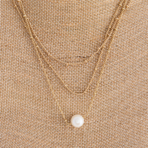 """Multi layered metal necklace with pearl pendant. Approximate 16"""" in length with .5"""" pendant."""