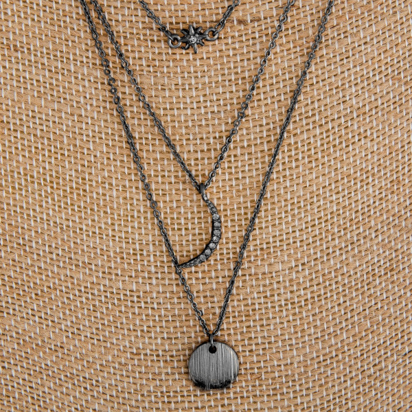 """Long metal layered necklace with moon and star charms. Approximate16"""" in length."""