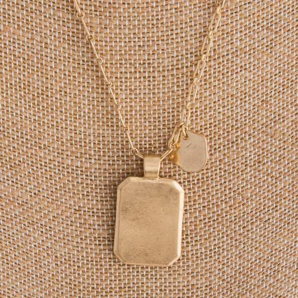 """Long metal linked chain with plate pendant. Approximate 16"""" in length with 1"""" pendant."""