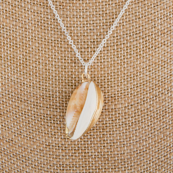"Long metal layered necklace with sea shell pendant. Approximate 18"" in length with 1"" pendant."