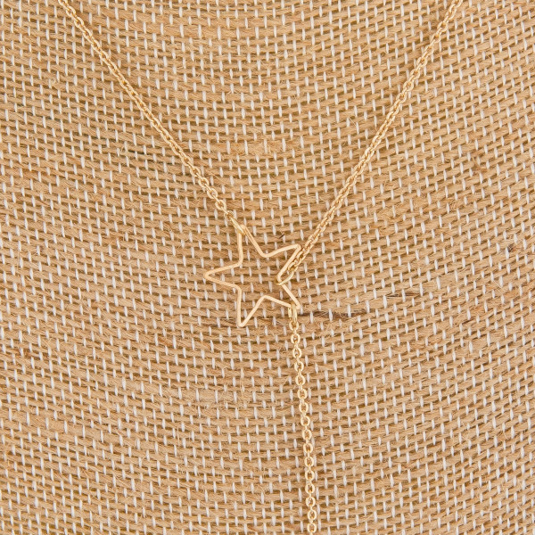 """Gorgeous metal """"Y"""" necklace with moon and star pendants. Approximate 24"""" in length."""
