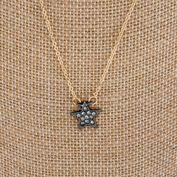 "Beautiful long metal necklace with star pendant with rhinestones. Approximate 24"" in length with 1"" pendant."