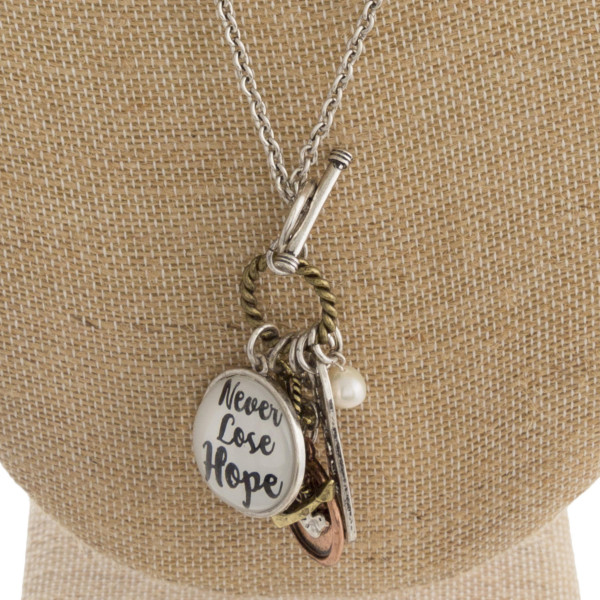 "Long metal necklace with inspirational messages and charms. Approximate 28"" in length."