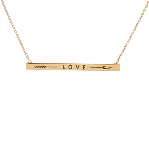 "Long metal necklace with engraved arrow and 'love' message. Approximate 16"" in length."