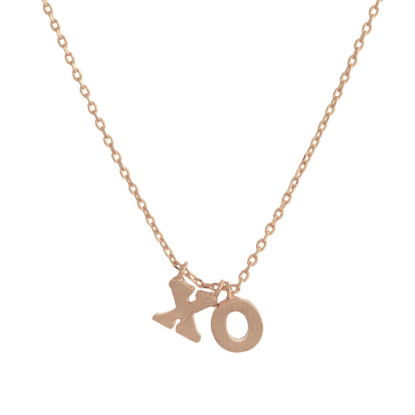"Metal necklace with small ""XO"" pendant. Approximate 18"" in length with 1"" pendant."