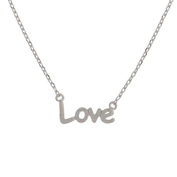 "Metal necklace with small ""Love"" pendant. Approximate 18"" in length with 1"" pendant."