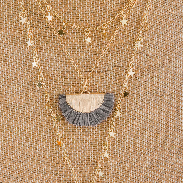 """Long layered necklace with tassel pendant and star charms. Approximate 20"""" in length."""