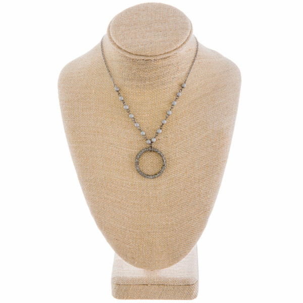 """Long metal necklace with beads and hoop pendant. Approximate 26"""" in length."""