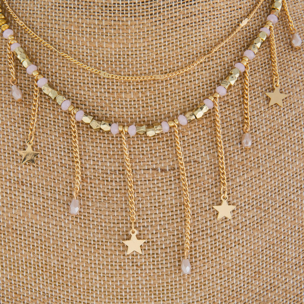 """Long beaded necklace with star charms. Approximate16"""" in length."""