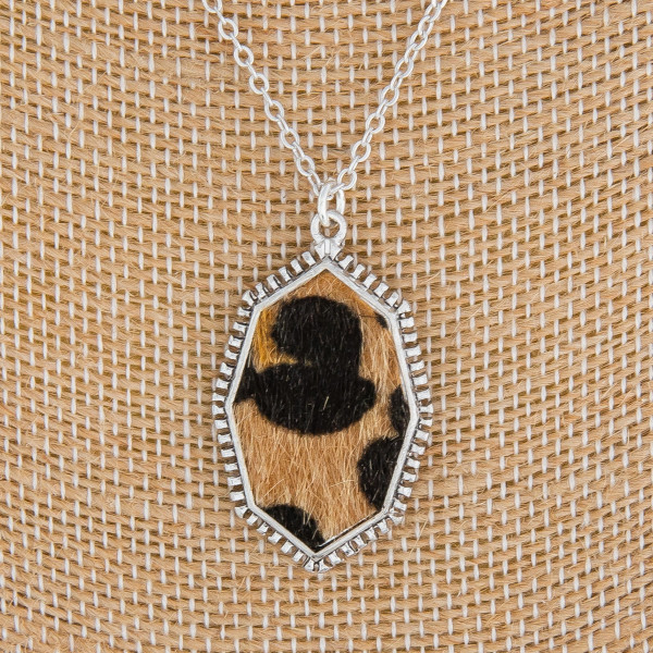 """Long metal necklace with animal detail pendant. Approximate 21"""" in length."""