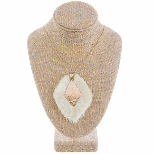 """Long metal gorgeous necklace with fanned tassel pendant with center gold detail. Approximate 40"""" in length. with 3"""" pendant."""