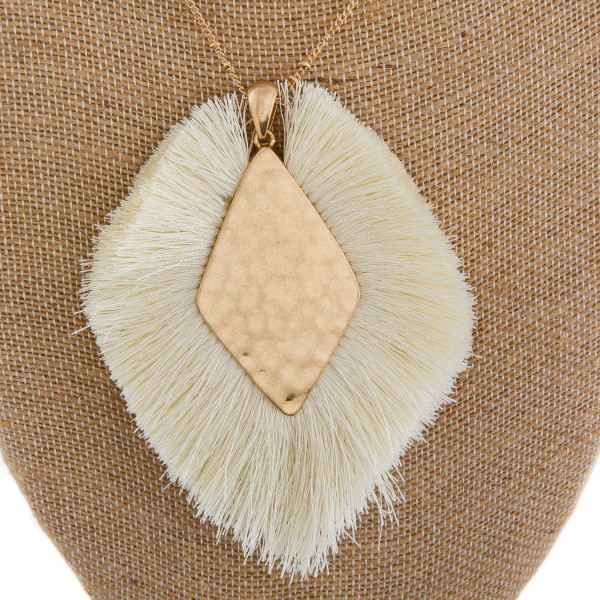 "Long metal gorgeous necklace with fanned tassel pendant with center gold detail. Approximate 40"" in length. with 3"" pendant."