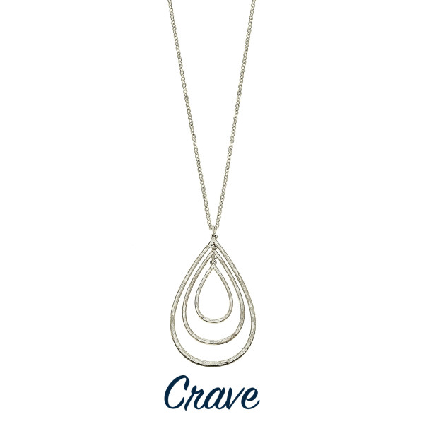 """Long necklace with distressed metal nested teardrop pendant. Chain is approximately 28"""" long. Pendant is approximately 2.25"""" long."""