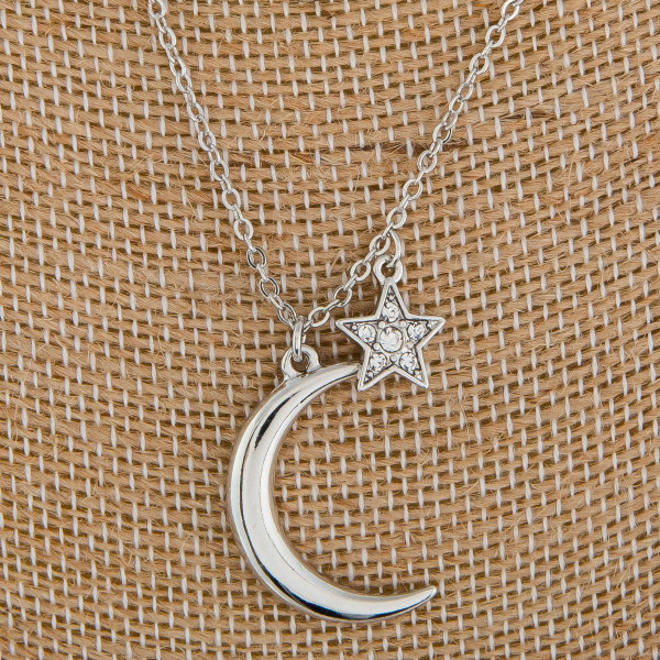 """Long metal necklace with charms and moon pendant. Approximate 16"""" in length."""