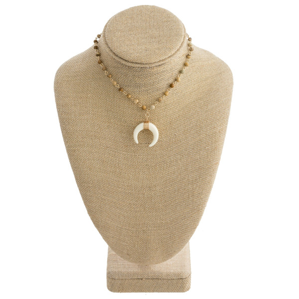 """Short beaded necklace with horn pendant. Approximate 13"""" in length."""