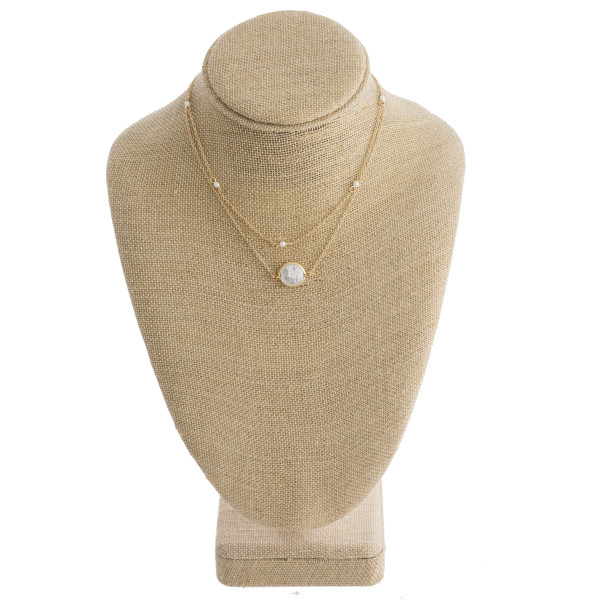 """Short metal layered necklace with pearl pendant. Approximate 14"""" in length."""